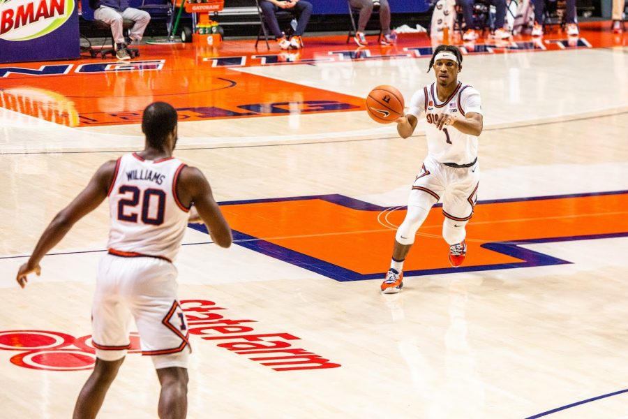 Senior Trent Frazier passes to senior Da'Monte Williams during the game against Wisconsin on Feb. 6. The Illinois basketball team will face off against Northwestern tonight.