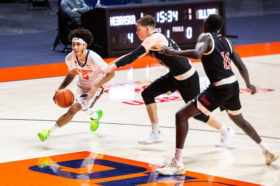 Freshman Andre Curbelo pushes down the court during the game against Nebraska on Thursday. The Illini won the game 86-70.