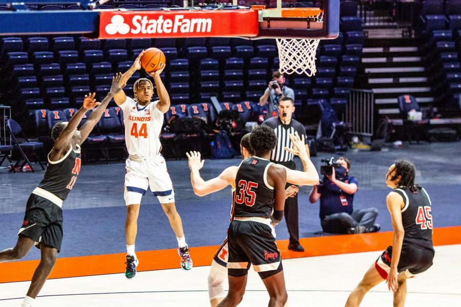 Adam Miller shoots a 3-pointer during Illinois
