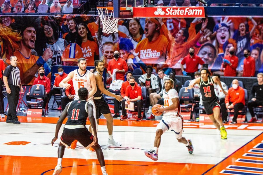 Adam Miller drives to the basket in Illinois' game against Nebraska on Thursday. Without Ayo Dosunmu, Miller stepped up for the team with 16 first-half points.