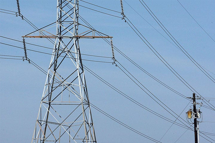An electrical tower holds wires high above the ground. The University of Illinois Facility and Services has asked residents to conserve energy as much as possible following heavy snowfall.