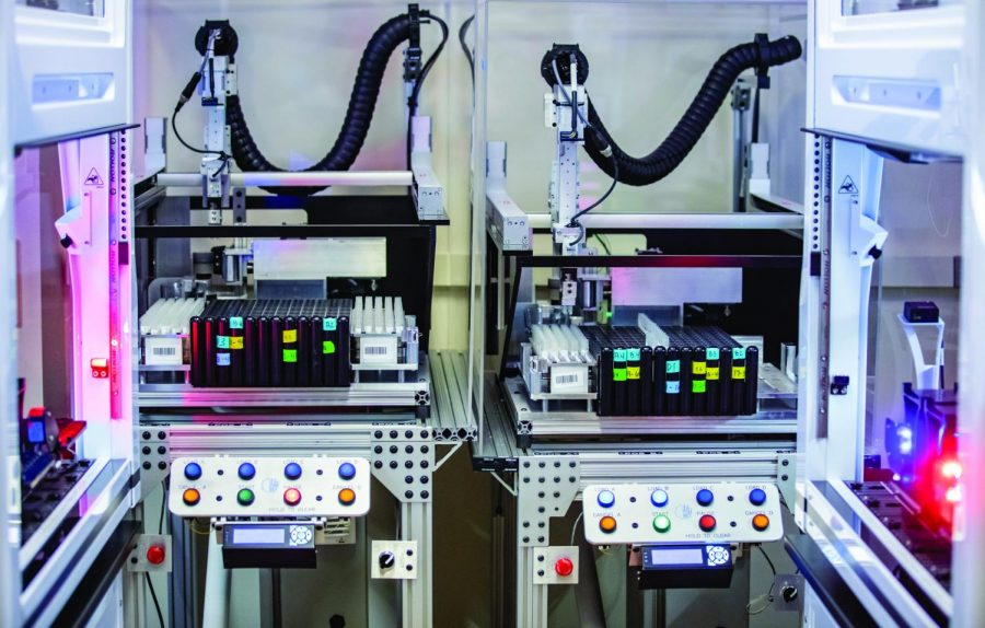 A robot processes COVID-19 saliva tests in the Veterinary Diagnostic Laboratory. The lab has delivered an average of 10,000 test results per day between Jan. 21 and Jan. 29.