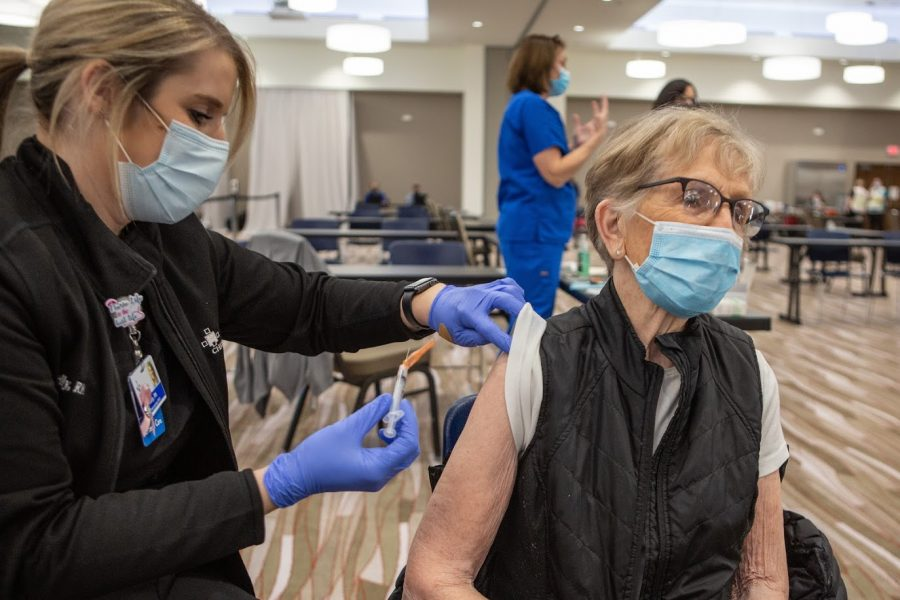 A Champaign County resident receives the Moderna COVID-19 vaccine at the I-Hotel on Jan. 12. Nearly 16.8% of Champaign County residents has received a first dose of the vaccine.