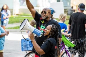 Titianna Ammons speaks at a March for Black Lives event over the summer in Urbana. Ammons is running for Urbana City Clerk.