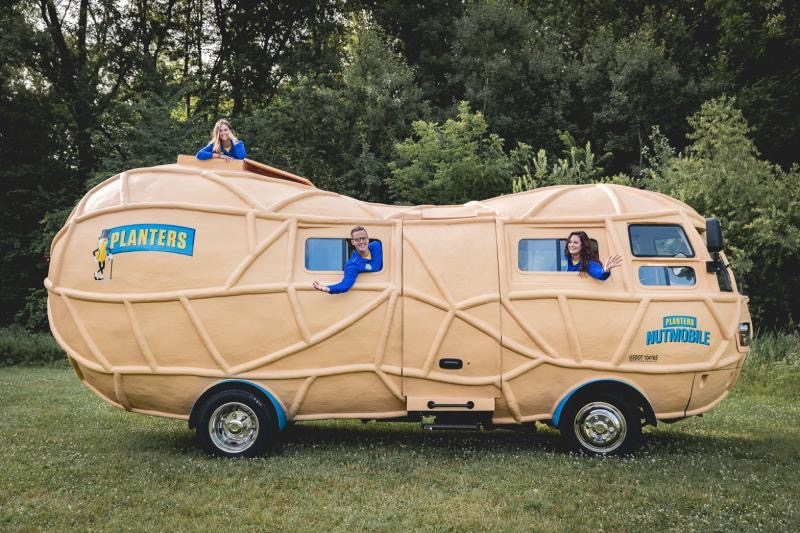 The Planters Peanutters wave from the Peanut Mobile while on the road. Tyler Towne, one of the peanutters, along with his coworkers recently made a stop in Champaign.