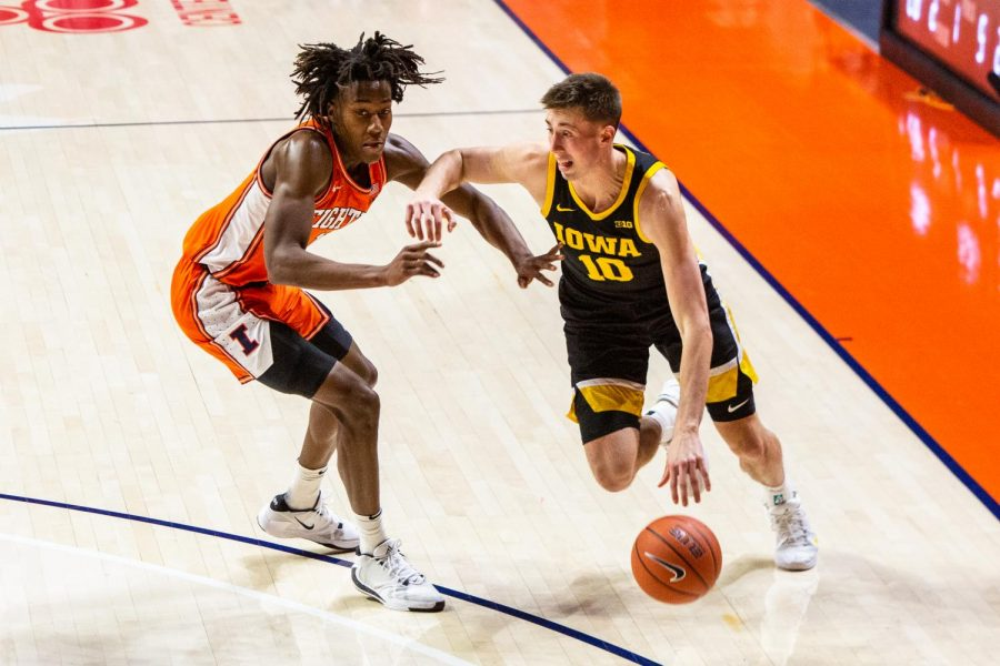 Ayo Dosunmu defends an Iowa player at State Farm Center on Jan. 29. Dosunmu recently recorded his second triple-double during the game against Minnesota on Saturday.
