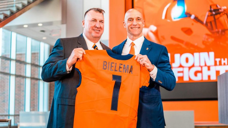 New Illinois head football coach Bret Bielema receives a personalized jersey from Josh Whitman on Dec. 22. Bielema plans to recruit future players from Illinois to increase chances of team success.