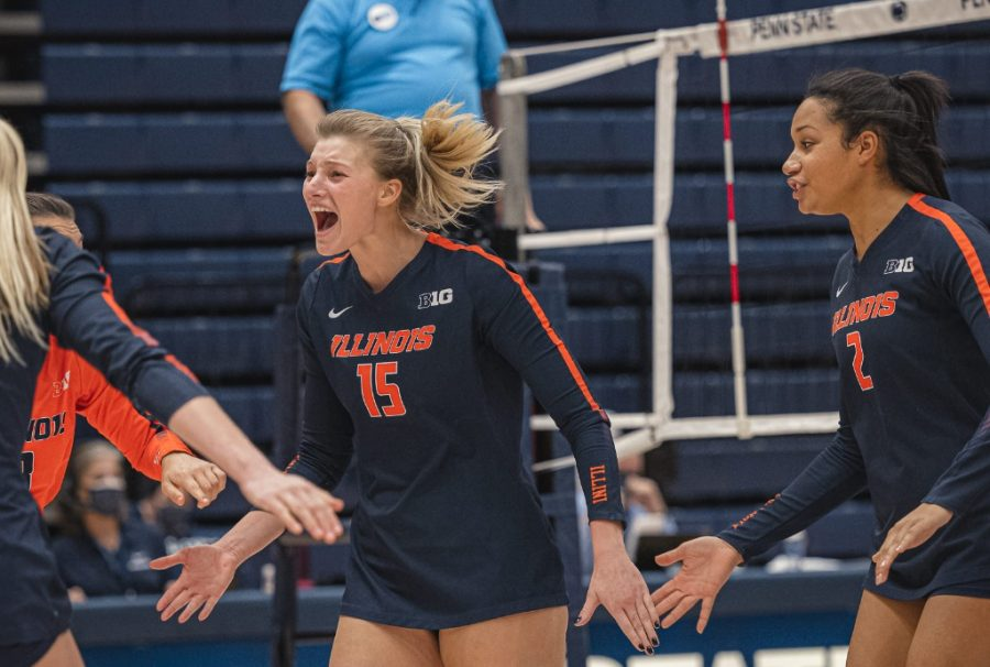 Senior Megan Cooney celebrates with her teammates after scoring a point during the match against Penn State on Feb. 5. Cooney is this week's Illini of the Week.