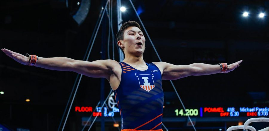 Gymnast Brandon Ngai poses after finishing a routine during competition in the 2017-2018 season. Ngai has now graduated from the University but found ways to maintain involvement in the sport.