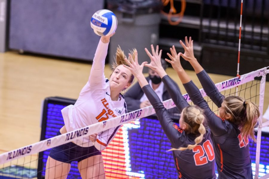Outside hitter Raina Terry hits the ball against Ohio State on Feb. 19, 2020 at Huff Hall. After overcoming mono in December, Terry has been a valuable player to the struggling Illini.