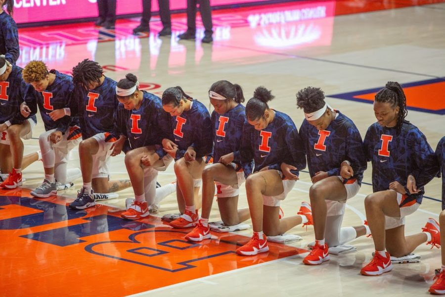 Members of the Illinois women's basketball team kneel during the national anthem before the game against Valparaiso on Dec. 2. The team is celebrating Black History Month in multiple ways.