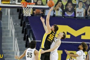 Iowa center Luka Garza goes up for a shot against Michigan guard Franz Wagner in the first half of their Big Ten basketball game at Crisler Center in Ann Arbor on Thursday.