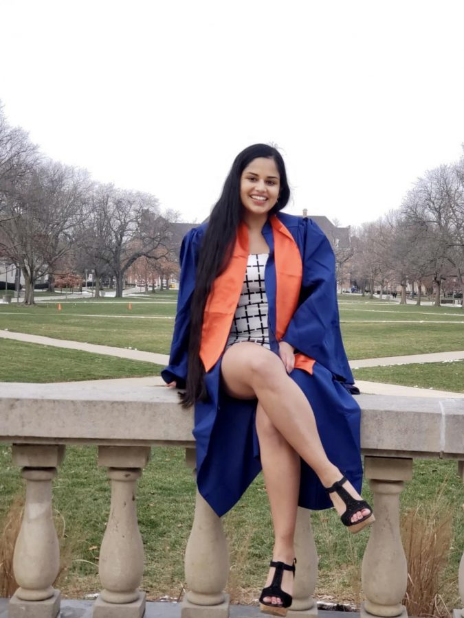Illinois graduate Surpreet Kaur poses for a graduation photo in front of Foellinger Hall. Kaur had difficulties finishing her final semester of college this past fall.