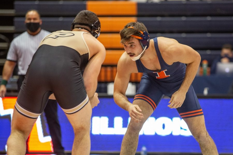 Illini wrestler Matt Wroblewski begins a match against Purdue on Jan. 24 at Huff Hall. Wroblewski has taken advantage of COVID-19 by working on his strength as the playoffs approach.