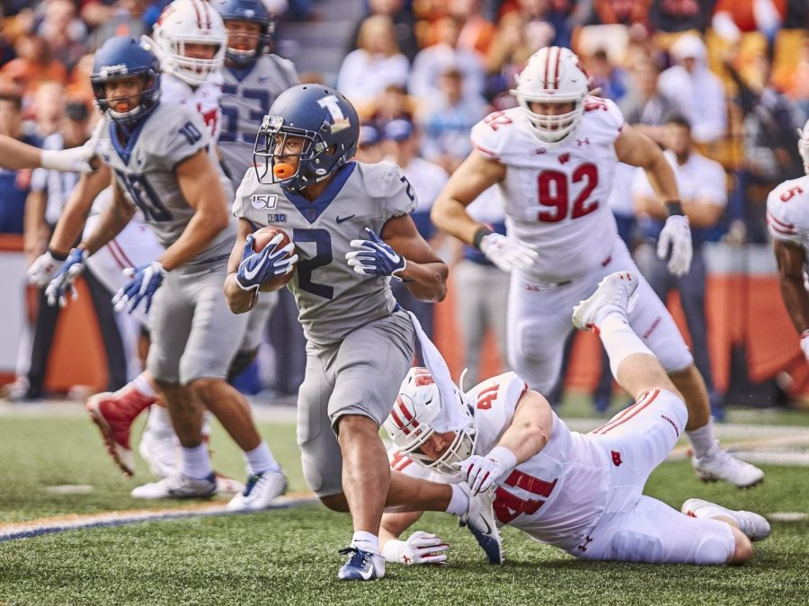 Former Illini running back Reggie Corbin rushes the ball during a game against Wisconsin at Memorial Stadium on Oct. 19, 2019. Corbin signed a deal with the BC Lions in Canada to continue his playing career.