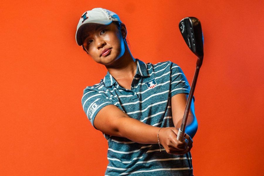Freshman Isabel Sy swings her club for a promotional image. Sy faced some challenges in moving from California to Illinois during a pandemic but has been welcomed by the team and quickly found her place.