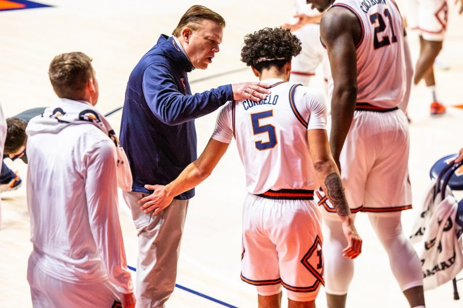 Illinois head coach Brad Underwood speaks to freshman Andre Curbelo during the game against Wisconsin on Feb. 6. Questions surrounding the team's consistency remain after a loss to unranked Michigan State on Sunday Tuesday night.
