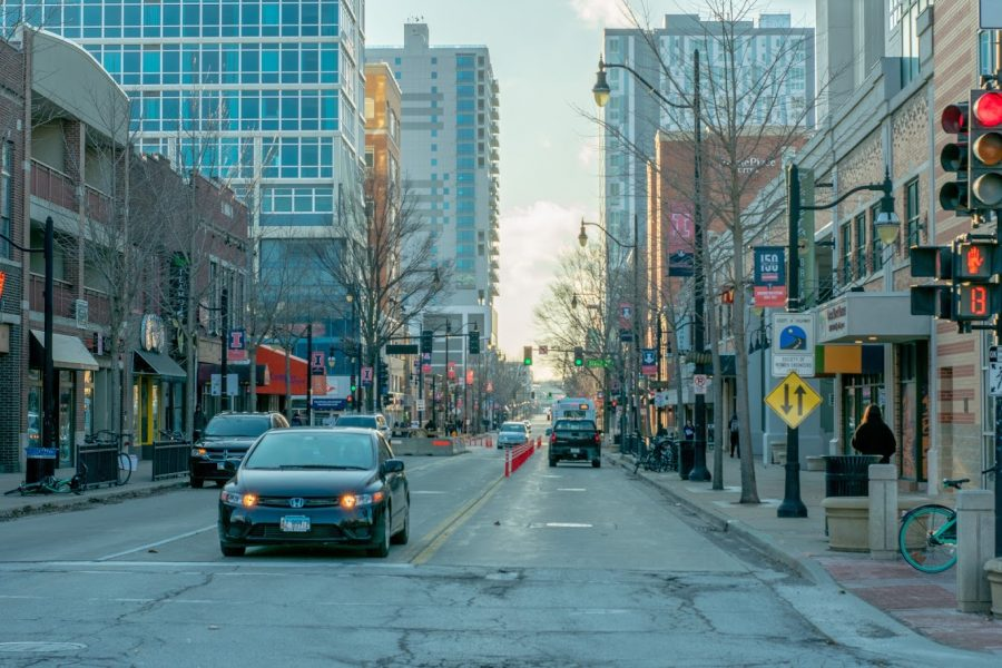Cars roll down Green Street in Champaign on Feb. 24, 2020. The City of Champaign has implemented new rules to prevent illegal parking on Green Street.