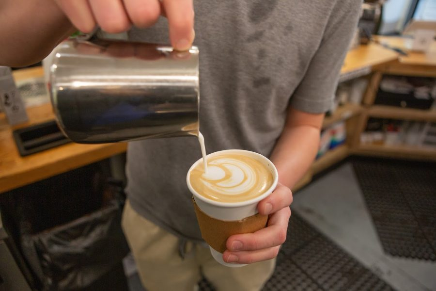 A+BrewLab+barista+pours+latte+art+on+Oct.+20.+BrewLab+is+one+of+several+local+establishments+that+offer+coffee.