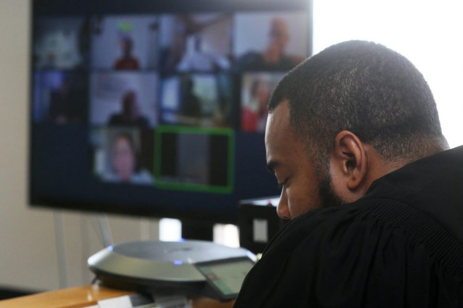 David Hamilton of Akron, Ohio listens during a Zoom meeting on Jan. 13. It is a good idea to research a company before you interview with them.