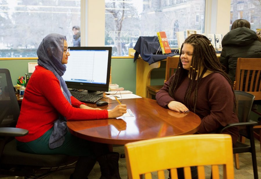 Career Center employee Shoptorshi Rahman, walks through a sample resume with student Alexis Young on Jan. 24, 2019. Choosing a path that you slightly fear is often a wise decision.