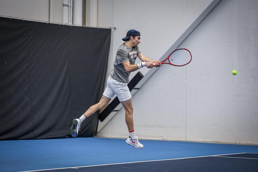 Redshirt freshman Alex Bancila returns the ball against Penn State on Feb. 19 at Atkins Tennis Center. The Illini won the match, 5-2.