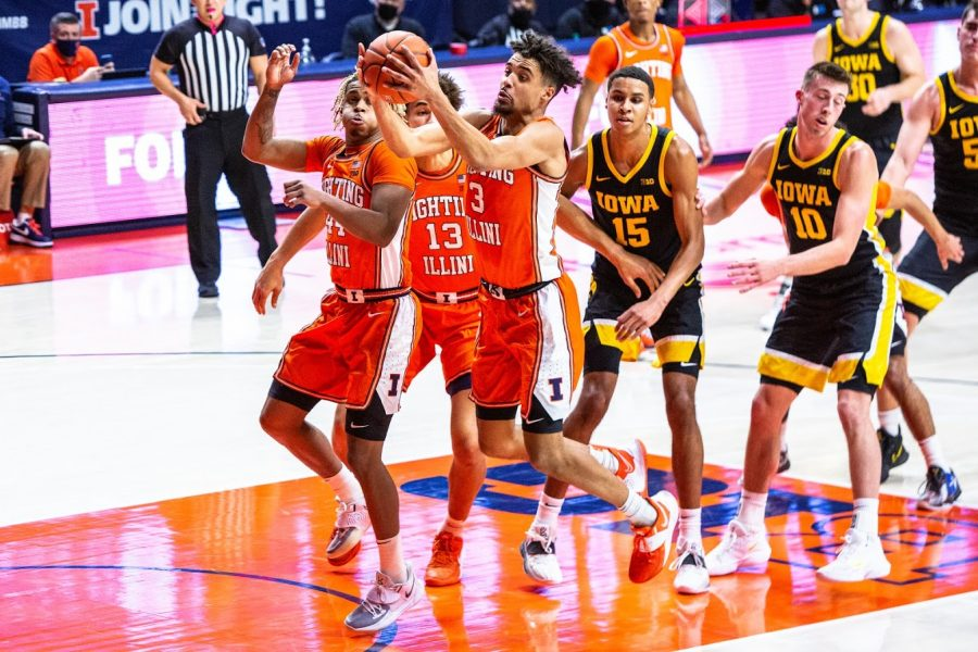 Junior forward Jacob Grandison captures a rebound during the game against Iowa on Friday. The Illini will face off against Indiana tonight in Bloomington.