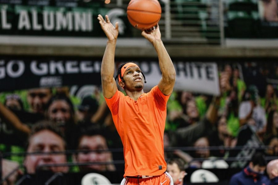 Trent Frazier shoots in warmups before Illinois' game against Michigan State on Tuesday night. The Illini fell 81-70.