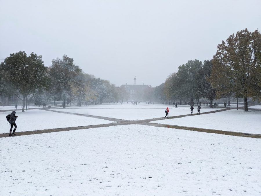Students walk on the Main Quad through the snow. The