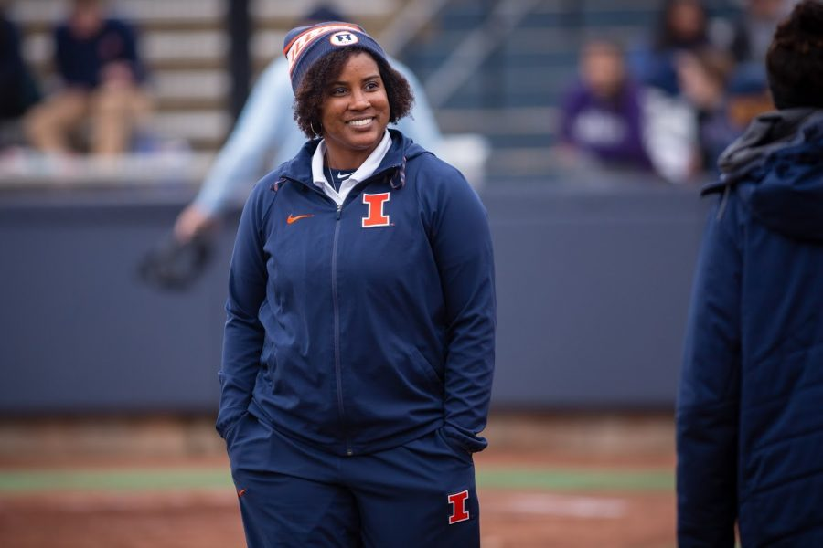 Illinois head coach Tyra Perry smiles as she walks past the Illinois dugout during the game against Northwestern at Eichelberger Field on Mar. 28, 2018.  Perry is excited for her team to begin play soon.