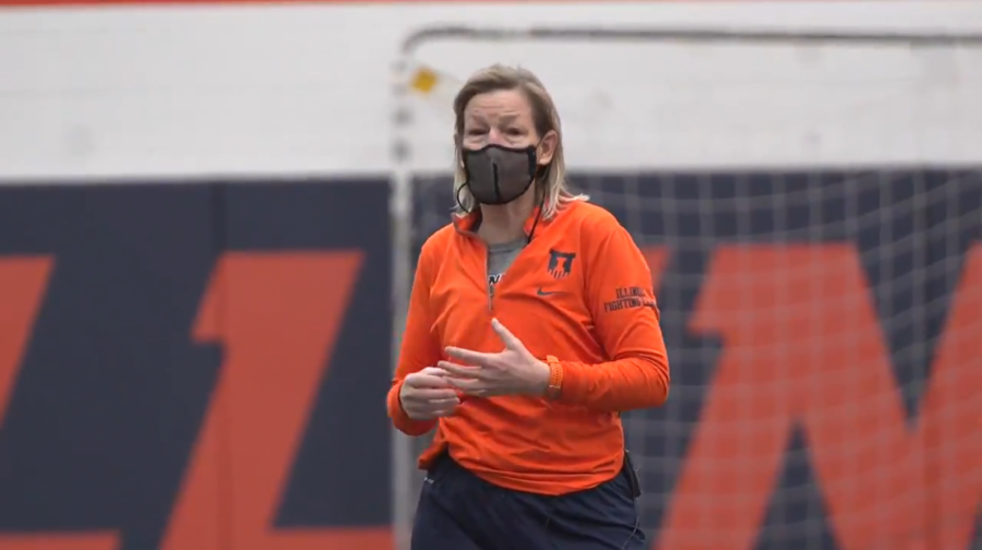 Illinois head soccer coach Janet Rayfield instructs her team during a recent practice. The team will play their first game today against Purdue.