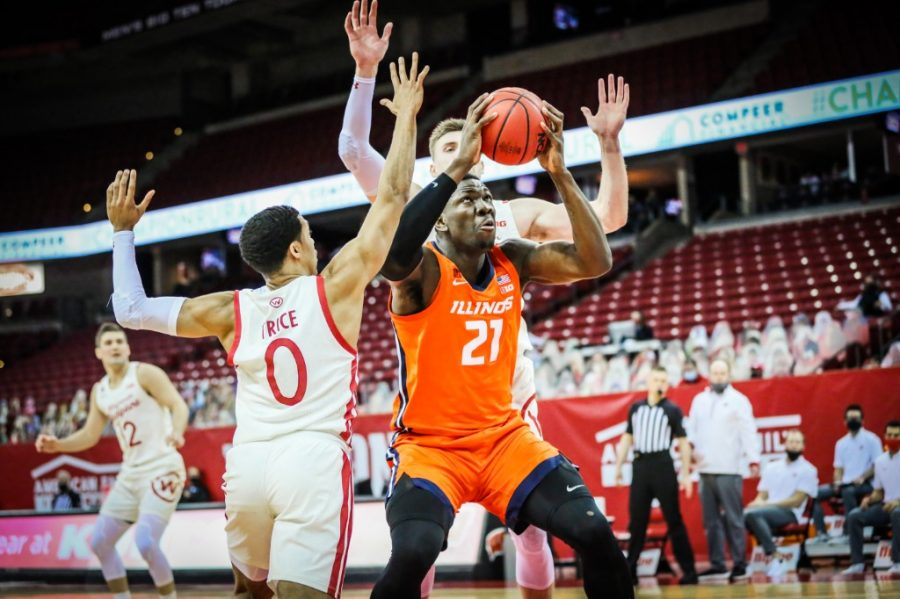Sophomore+Kofi+Cockburn+looks+to+shoot+during+the+game+against+Wisconsin+on+Saturday.+The+Illini+won+the+game+74-69.