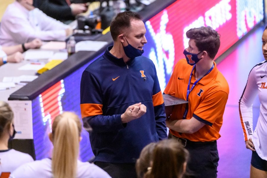 Illinois head coach Chris Tamas speaks to his team during a time out at the match against Ohio State on Friday. The team now has a 2-6 record.