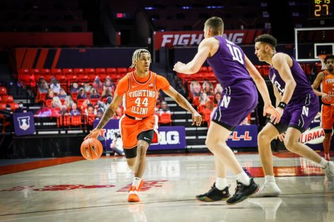 Freshman Adam Miller pushes forward during the game against Northwestern on Tuesday. Illinois prevailed over Northwestern 73-66.