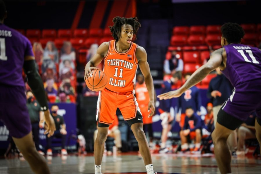 Junior Ayo Dosunmu looks downcourt during the game against Northwestern on Tuesday. The Illini will face Minnesota tonight.