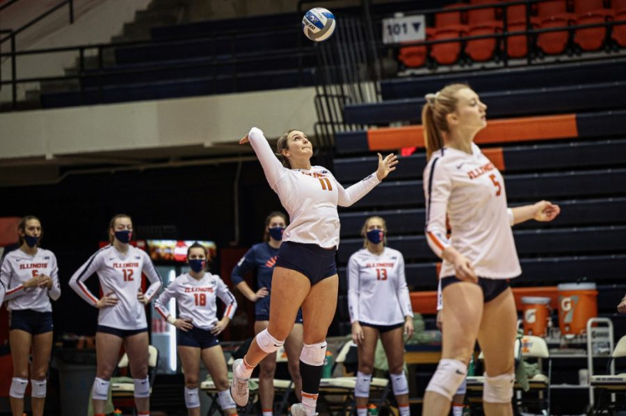 Redshirt Freshman Ellie Holzman serves during the match against Wisconsin on Sunday. The Illini will face off against Penn State tonight and tomorrow.