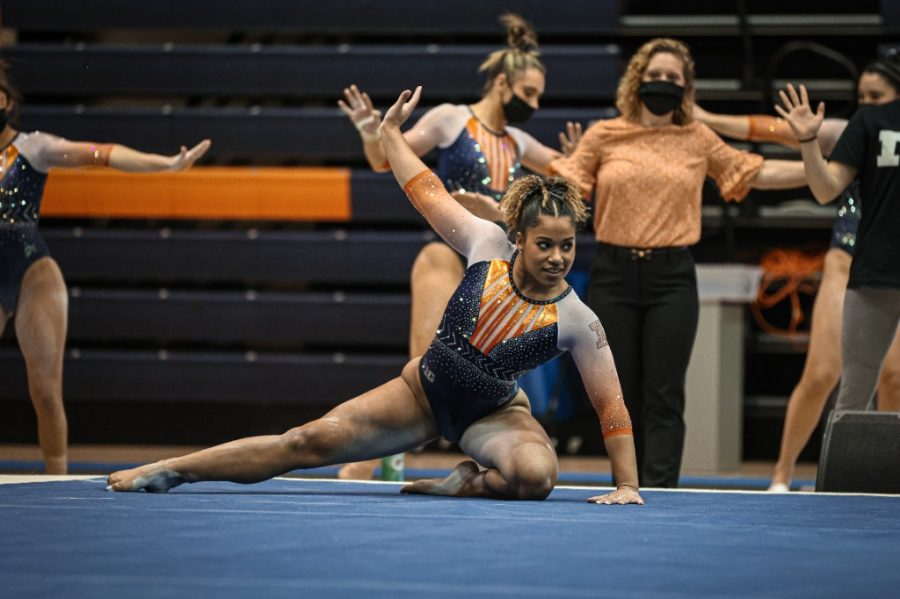 Sophomore+Mia+Townes+performs+her+floor+exercise+routine+during+the+meet+against+Michigan+on+Sunday.+The+Illinois+women%27s+gymnastics+team+placed+second+in+the+Big+Five+Meet+on+Friday.