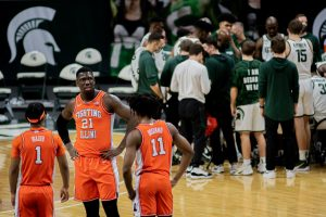 Trent Frazier, Kofi Cockburn and Ayo Dosunmu stand together on the court during Illinois' game at Michigan State. The Illini lost 81-70.