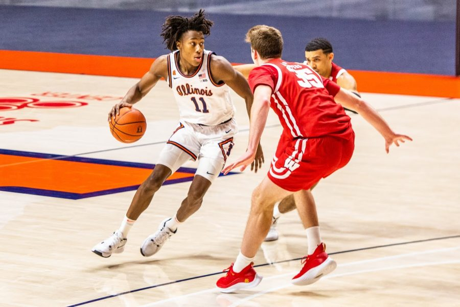 Junior+Ayo+Dosunmu+attempts+to+pivot+around+two+defenders+during+the+game+against+Wisconsin+on+Feb.+6.+Dosunmu+won+the+Bob+Cousy+Award+Saturday+afternoon.