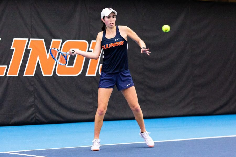 Freshman Kate Duong returns the ball during a match against Wisconsin on Feb. 26. Illinois will face Iowa today.