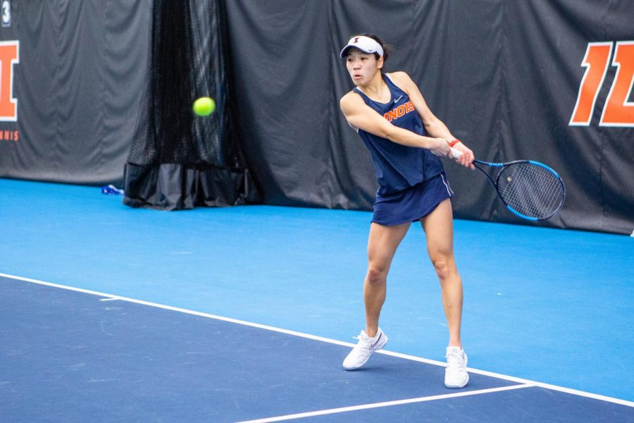 Senior Asuka Kawai begins a backhand swing during a match against Wisconsin on Feb. 26. The Fighting Illini women's tennis team is scheduled to play Wisconsin and Minnesota this weekend in their respective cities.