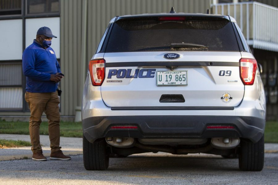 A University police officer is parked at a crime scene after responding to a call on Oct. 8. Columnist Matthew Krauter argues that the University of Illinois Police Department shouldn't be defunded to then allocate money towards mental health resources because they are separate issues and should be dealt with as such.