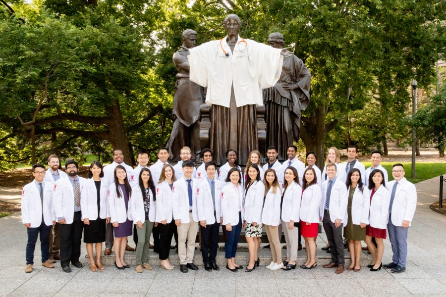 The Carle Illinois College of Medicine's first class poses for a group photo in front of the University's Alma Mater on July 3, 2018. The college recently received provisional accreditation for the quality of their education.