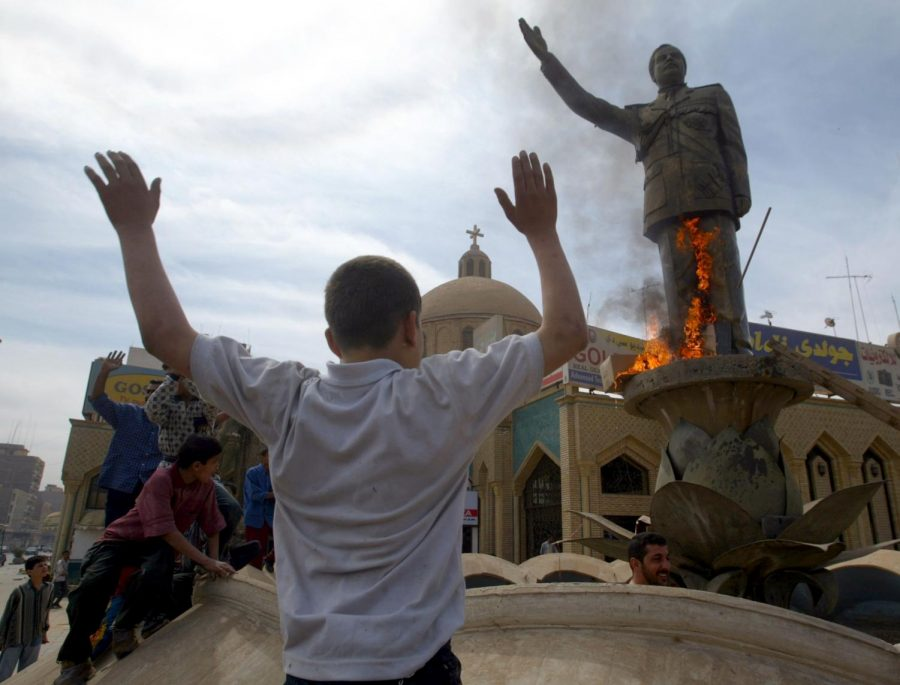 Iraqis gather and cheer as they burn a statue of Iraqi President Saddam Hussein in downtown Baghdad, Iraq, on  April 12, 2003. Columnist Nathaniel believes the United States efforts in the Middle East have accomplished nothing.