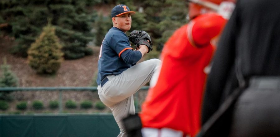 Junior Nathan Lavender winds up for a pitch during a game. The Illinois men's baseball team is set to play in Champaign for the first time in over a year against Northwestern today.