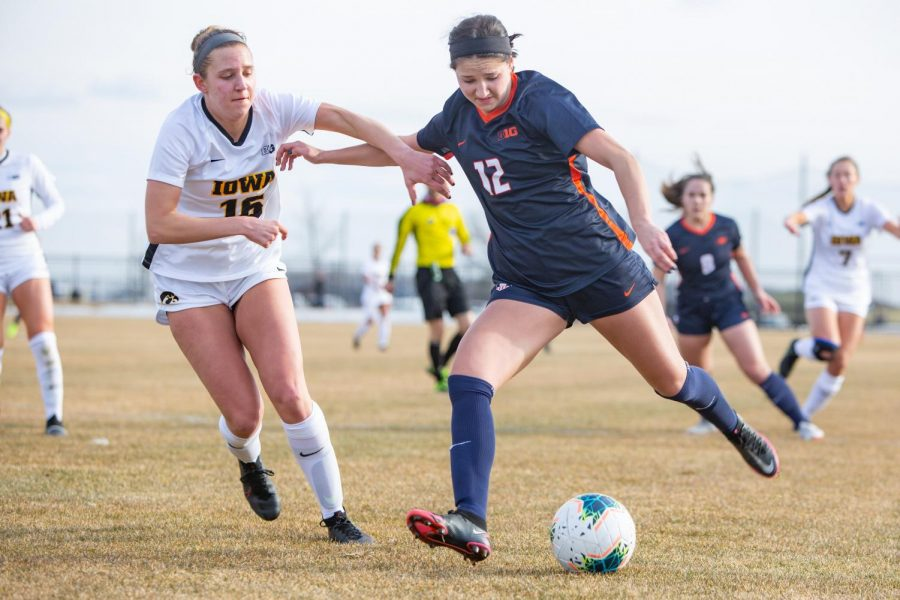 Redshirt sophomore Kendra Pasquale runs past Iowa's defense on Feb. 26. The Fighting Illini beat the Nebraska Cornhuskers 3-1 this morning at  Demirjian Park.