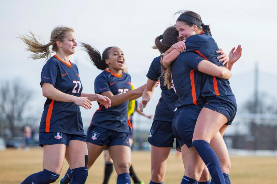 The Fighting Illini women's soccer team embraced during a game against Iowa on Feb. 26. The team continues to keep their momentum for upcoming games.