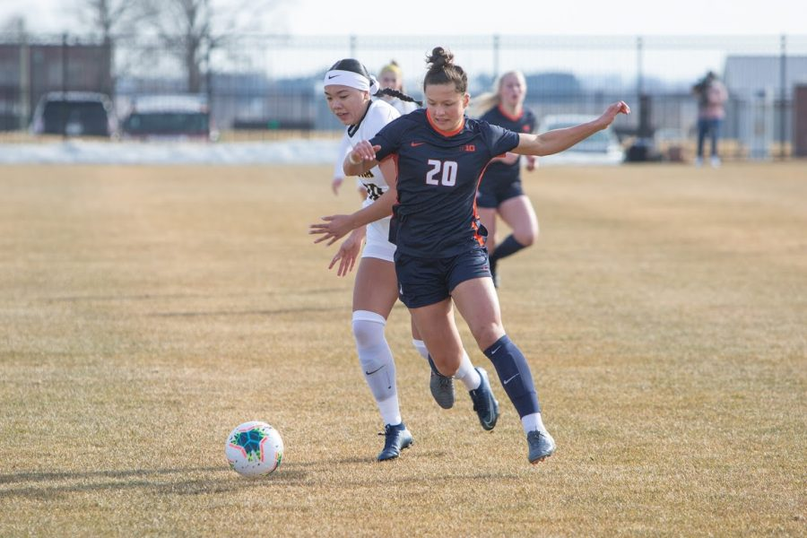 Junior Makena Silber battles for control of the ball during the game against Iowa on Feb. 25. The Illinois soccer team drew against Minnesota on Sunday.