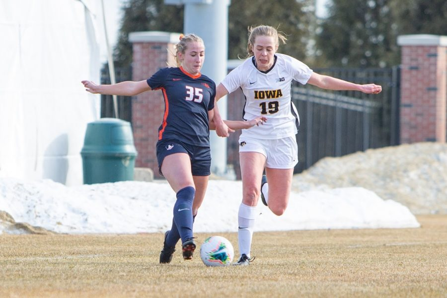 Junior Lauren Stibich battles for control of the ball during the game against Iowa on Feb. 25. The Illinois soccer team fell to Wisconsin 1-0 on Thursday.