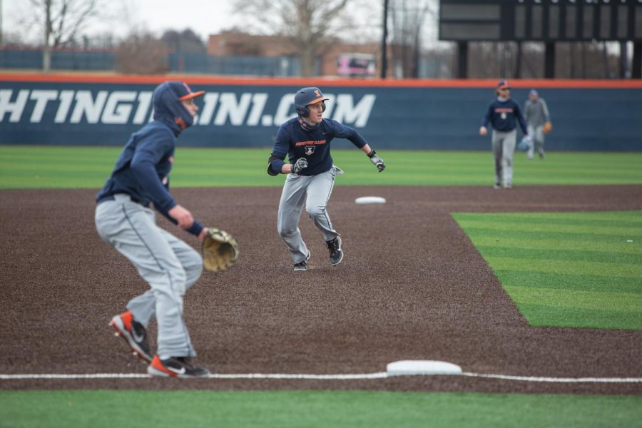 Senior Jackson Raper sprints to third base during practice on Feb. 26. The Illinois baseball team won and lost a game against the University of Michigan as well as suffering another loss against Michigan State in Ann Arbor this weekend.